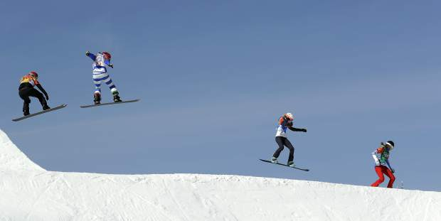 Meghan Tierney, Eagle, is second from left in this shot from the and snowboard cross quarterfinals in the Phoenix Snow Park at the 2018 Winter Olympics. Tierney finished 17th in the competition, facing challenging conditinos on an intimidating course that took over 5 years to design.