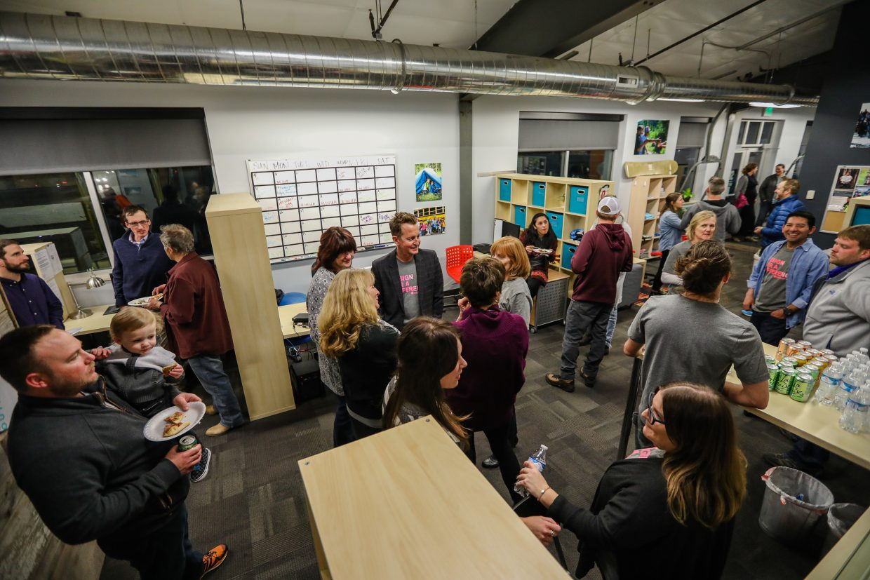 People mingle in the new space of SOS Outreach in the official unveiling of the redesign by Avon-based Select Surfaces on Monday, Feb. 12, in Edwards. Utilizing the most of the space they had, the redesign not only makes it more inviting but more functional.