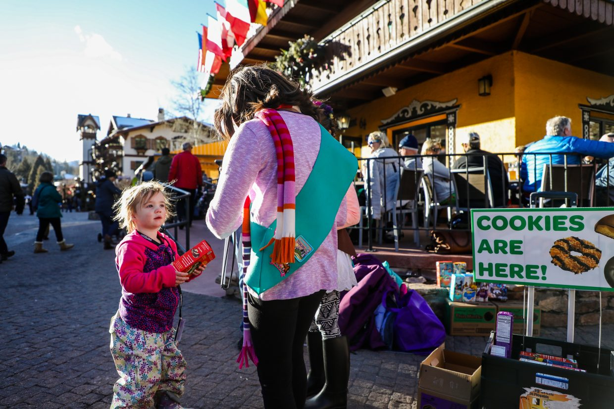 Larkin Pauls, 3, of West Vail buys a box of Tagalongs Girl Scout Cookies from Sofia, 9, and Alexa 7, Martinez on Sunday, Feb. 18, in Vail Village. Girl Scouts will be out today, Monday, Feb. 19, in the village selling cookies.