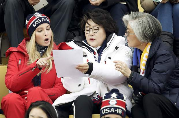 Ivanka Trump, left, talks with Kim Jung-sook, wife of the South Korean President and South Korean Foreign Minister Kang Kyung-wha, right, during the men's Big Air snowboard competition at the 2018 Winter Olympics in Pyeongchang, South Korea, Saturday, Feb. 24, 2018.