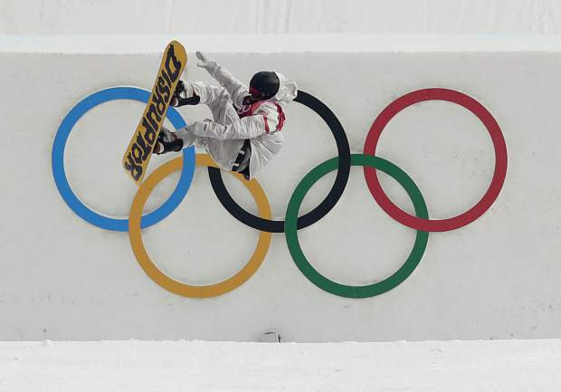 Kyle Mack, of the United States, jumps during training for the men's Big Air snowboard competition at the 2018 Winter Olympics in Pyeongchang, South Korea, Saturday, Feb. 24, 2018.