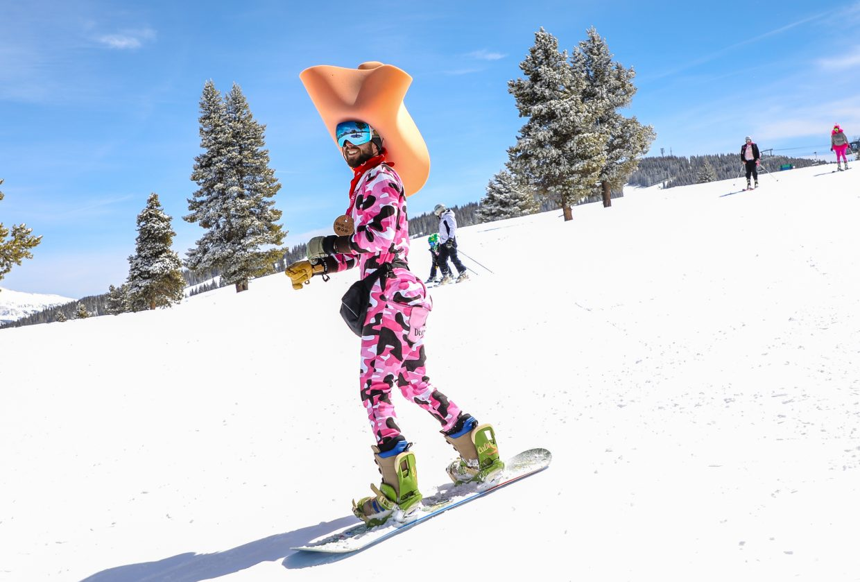 Taylor Glassco shreds down Vail during Pink Vail on Saturday, March 24, in Vail. The annual event draws thousands in pink costumes to rally around defeating cancer.
