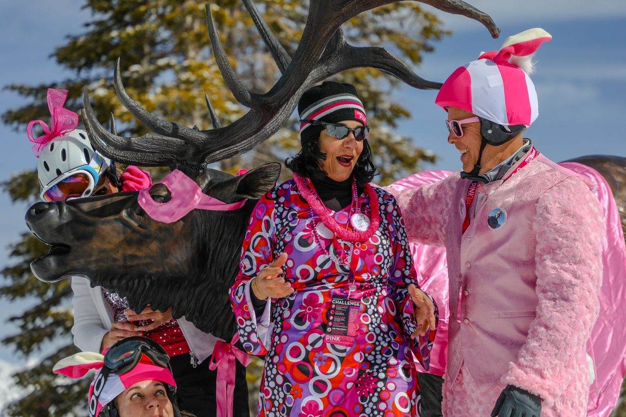 Judy Laspada of Edwards, Val Ropes, Andrea Eddy and Doug Russel, of Avon, socialize around the Two Elk, decked out in pink, during Pink Vail in 2018.