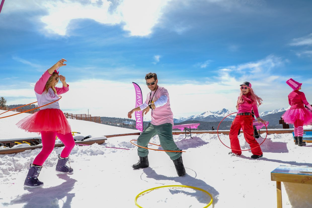 john Brice, center, Jessica McKeown, left, and Ashley Weeks hula-hoop at the top of Lionshead during Pink Vail on Saturday, March 24, in Vail. The three decks had different activities for people to enjoy.