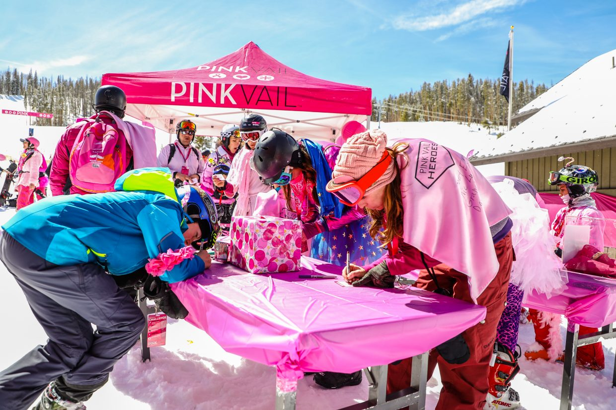 People write cards to those known affected by cancer at the new Pink Vail deck, Waffle Way, on Saturday, March 24, in Vail. Three official decks around the mountain welcomed guests of the event.