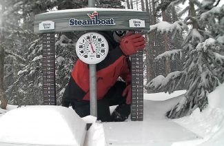 A Steamboat Ski Patrol member clears snow Wednesday from the Powder Cam.