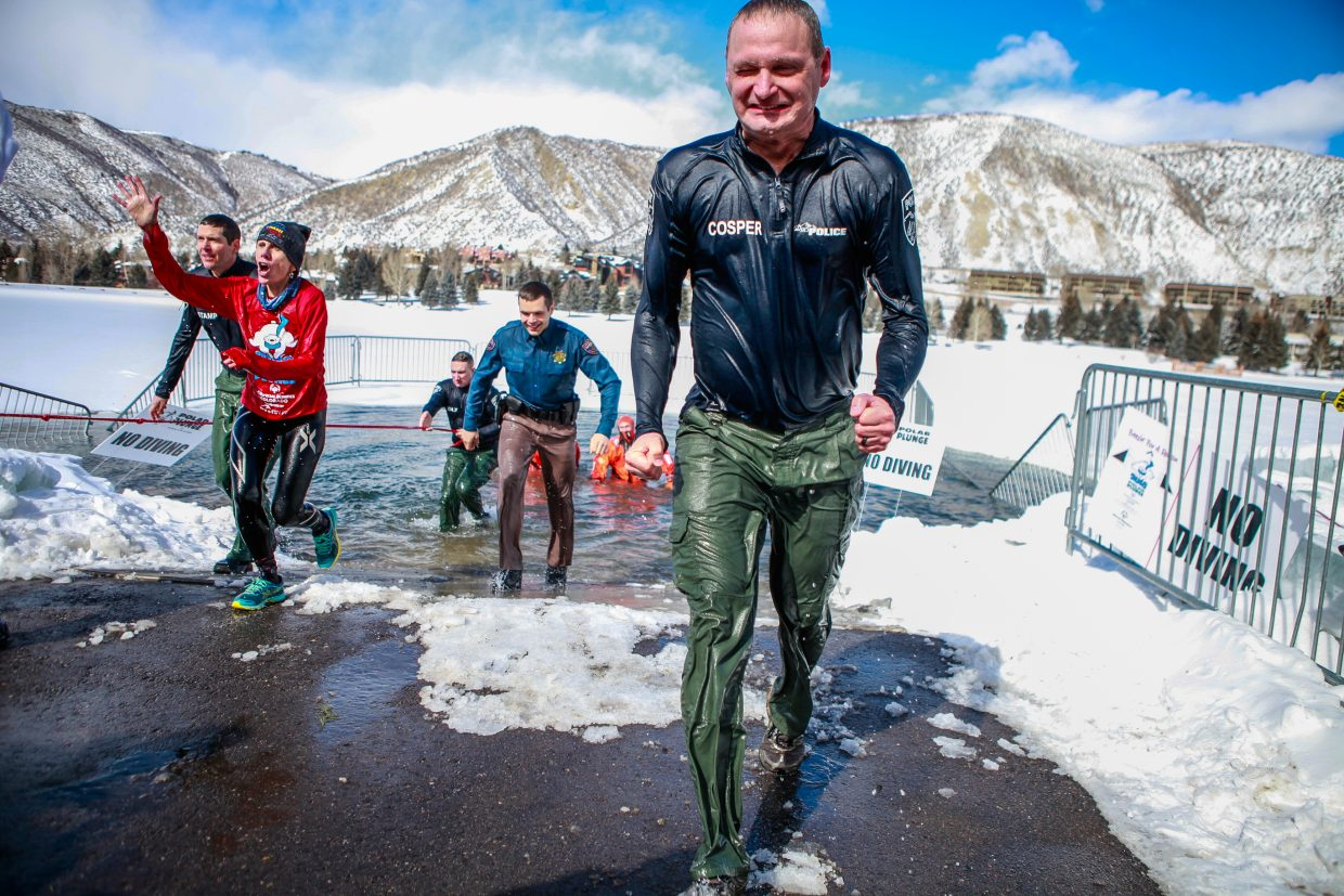 Deputy Chief of Police, Coby Cosper puckers after doing the Polar Plunge benefiting the Special Olympics of Colorado on Saturday, Feb. 24, in Avon. The water temperature measured a mere 12.9 degrees Fahrenheit.
