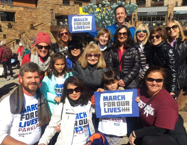 A group of local ladies from the Arrowhead Alpine Club join with families from Parkland, Florida, and Colorado State Representative Dylan Roberts during the March for Our Lives in Vail on March 24.