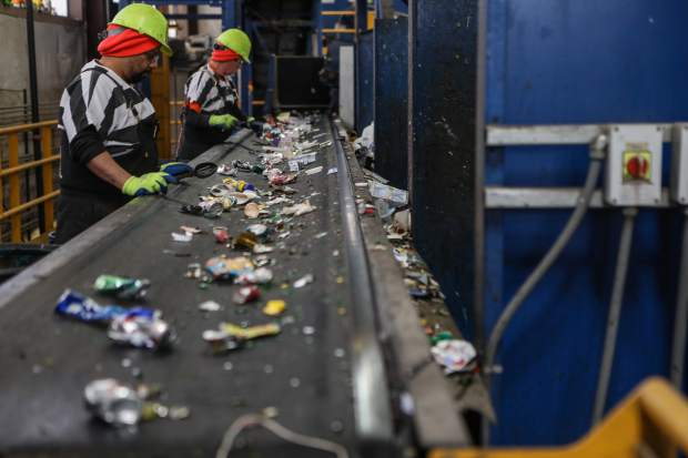 Workers sort the last bit of contaminants from the recycling at the Eagle County recycling center as the aluminum ends the process on Thursday, April 19, in Wolcott. The recycling that is brought to the facility is dual-stream recycling only. This recycling comes from the Eagle County drop sites, such as Vail, Edwards and Gypsum, as well as certain contracts around the county. The facility is only running around 25 percent.