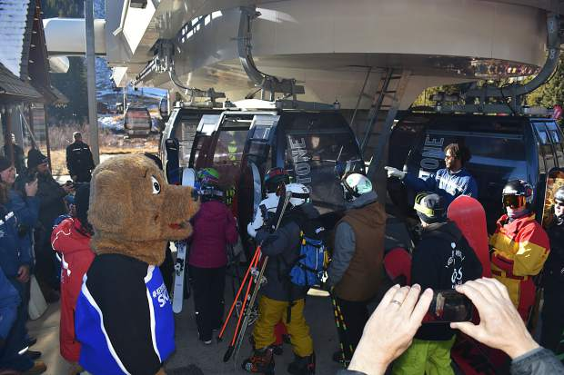 Copper resident Frank Walter, age 95, greets skiers and snowboarders at the base of the American Eagle chairlift during opening day Friday, Nov. 10, at Copper Mountain Resort.