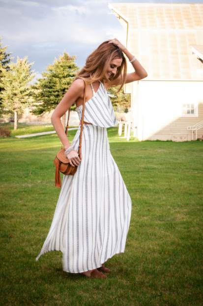 Maxi by Stella Sky, carried at Valley Girl Boutique; and purse is carried at Wild Heart.