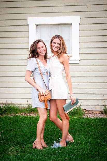 Purse, clutch and dresses are carried at Wild Heart in Edwards.