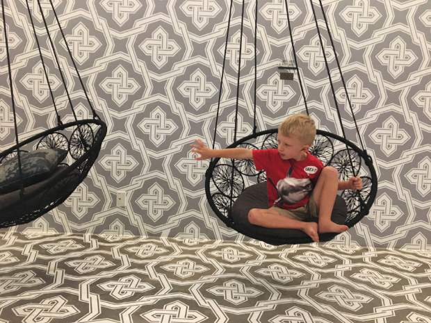 The Maven in Denver's LoDo entertains kids with swings in some of the rooms and outside the elevators on every floor.