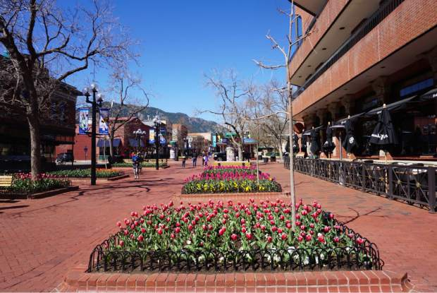 Pearl Street in Boulder offers free entertainment for kids with climbing statues and a spray park.