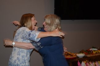 photo - Amy Jenkins embraces her sister Cindy Balthesar