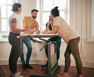 Instead of sitting in a conference room, try standing up at your next office meeting to improve movement and circulation.