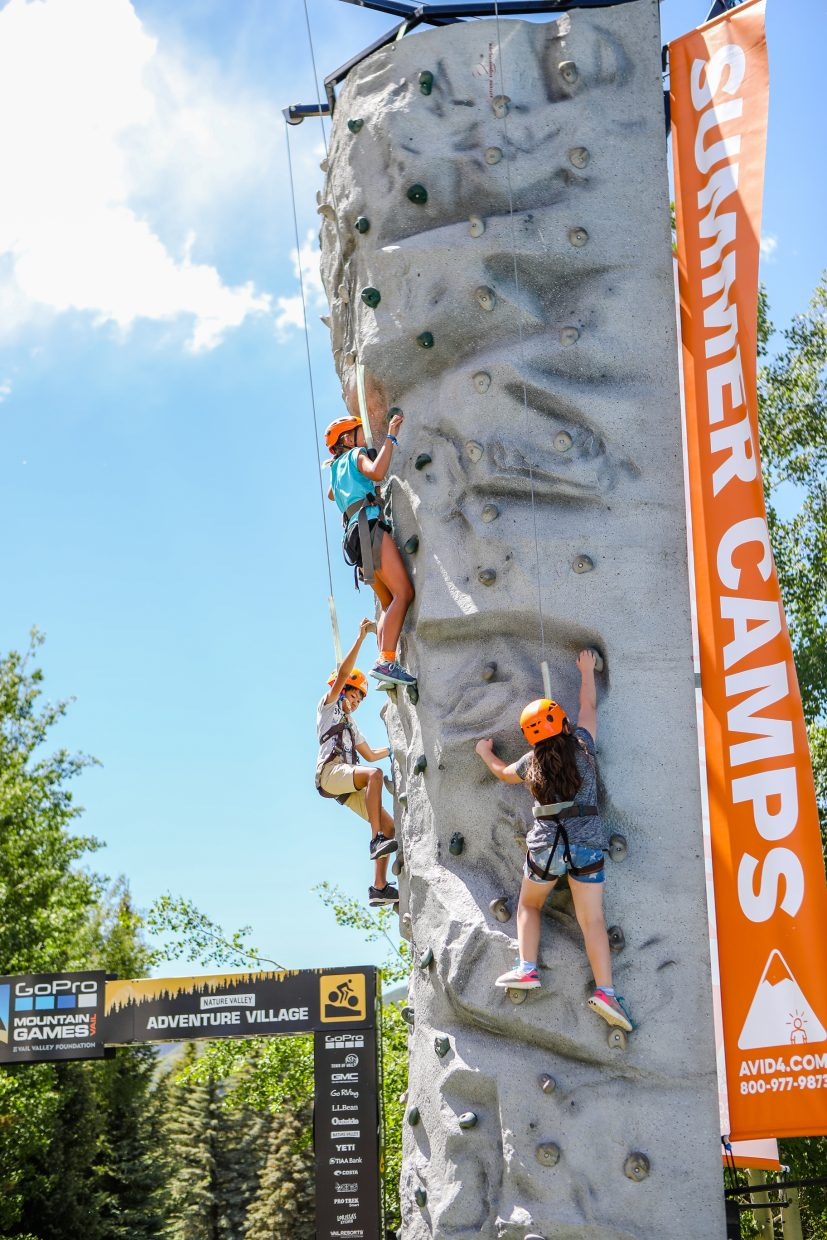 Kids climb in Adventure Village during the GoPro Mountain Games on Friday, June 8, in Vail.