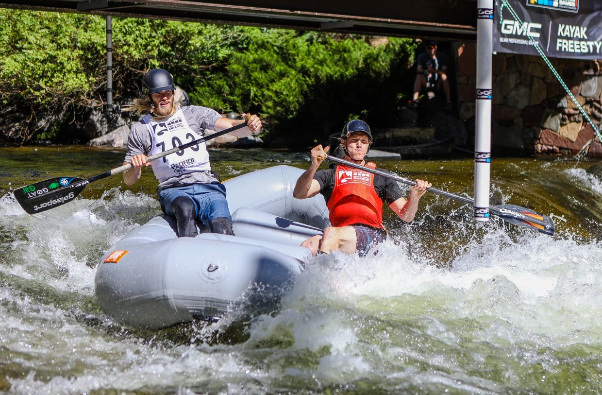 Jeremiah Williams and Rob Prechtl take the heat in the Raft Cross on Friday, June 8, in Vail.