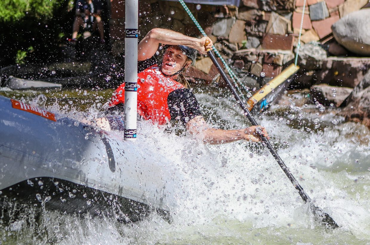 Rob Prechtl digs hard during the Raft Cross on Friday, June 8, in Vail.