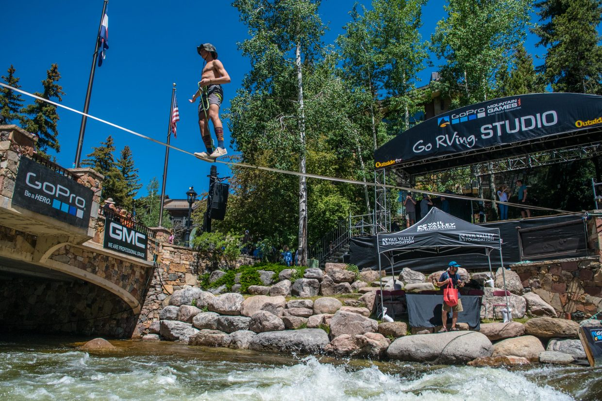 Davis Hermes performs on a high line above Gore Creek on Thursday during the Slackline Industries demonstration.