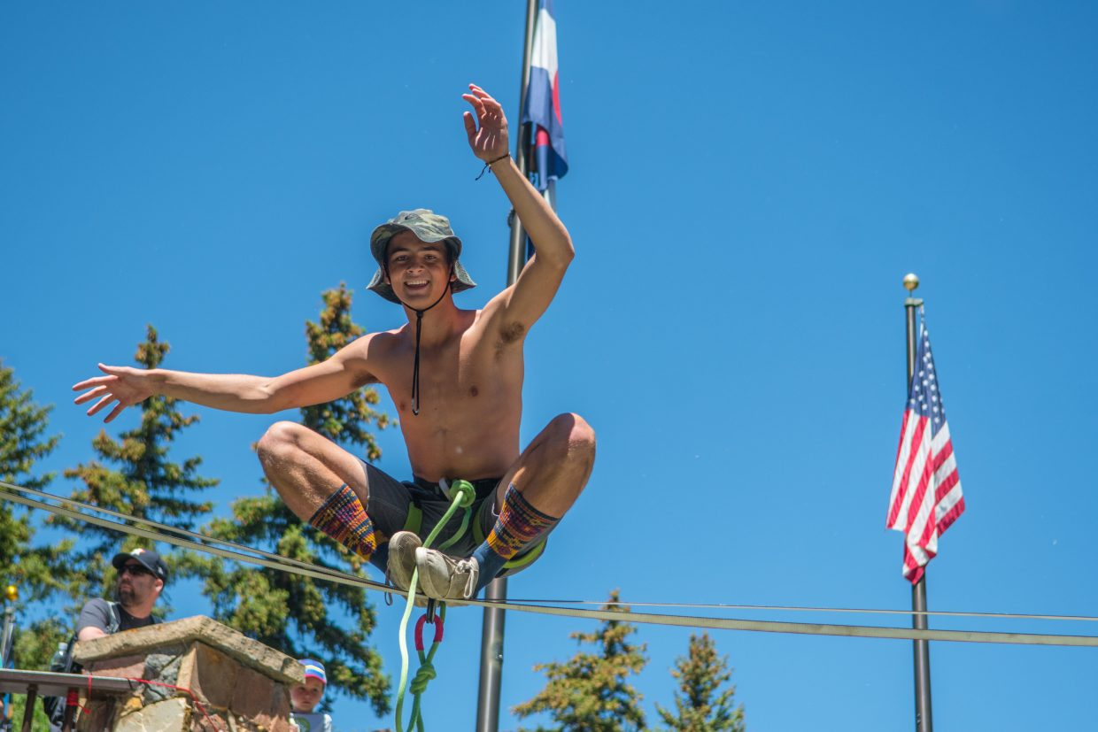 Davis Hermes balances on the outside of his feet to show spectators the difficulty of slacklining on Thursday.