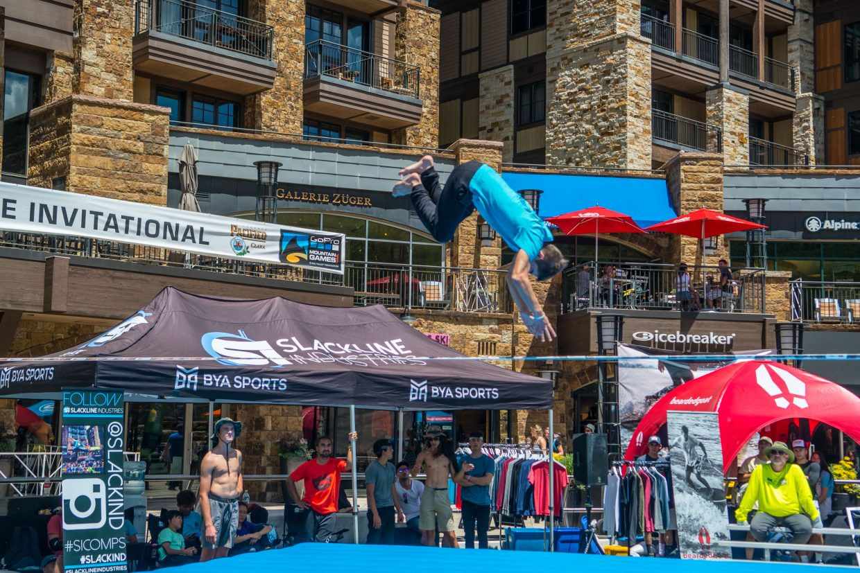 Spectators watch as athletes perform spins, flips, and other various tricks on taught lines no wider than 3 inches.
