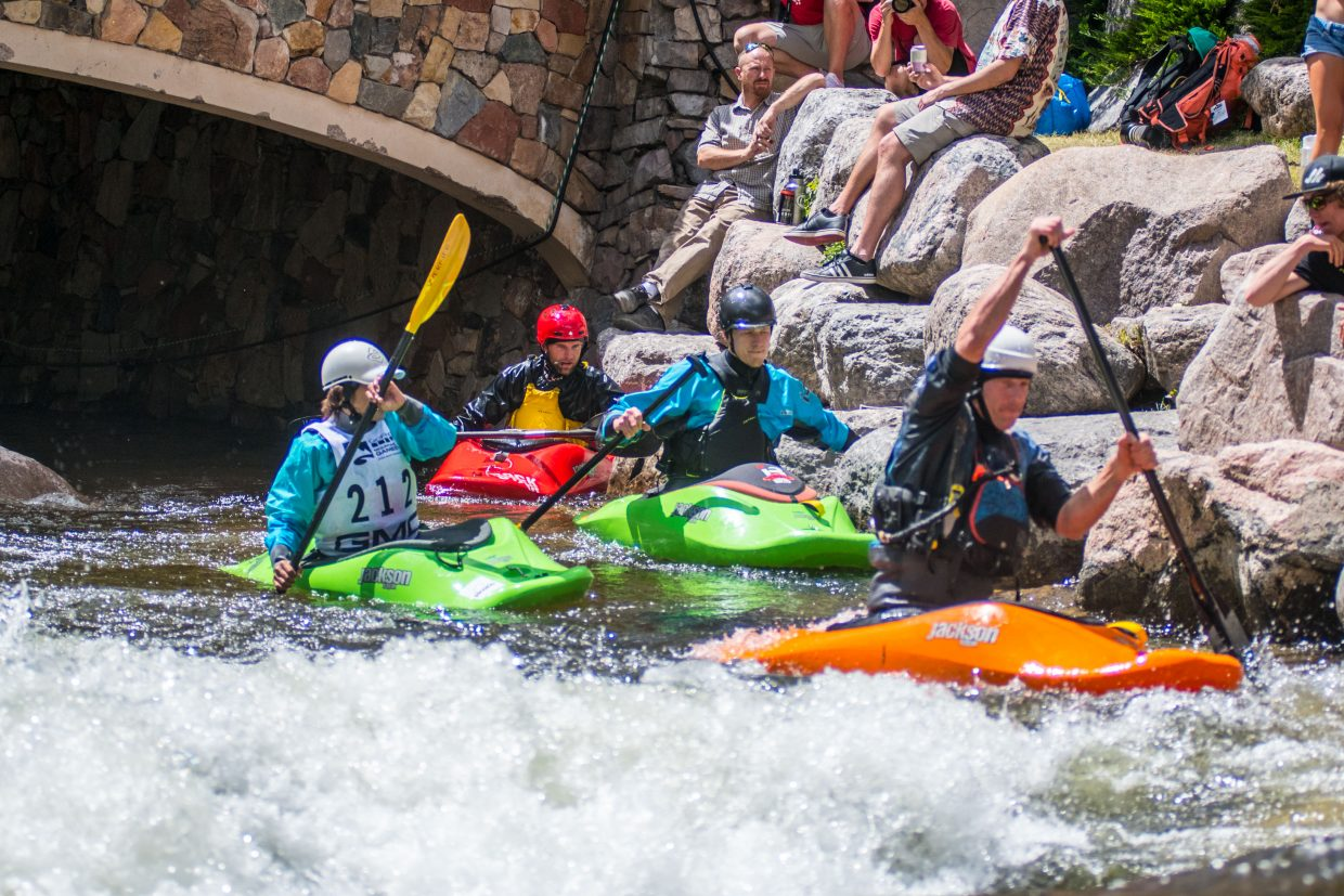 Freestyle Kayakers wait for their turn in the wave, a man-made wave that kayakers perform unbelievable tricks in during the Gopro Mountain Games.