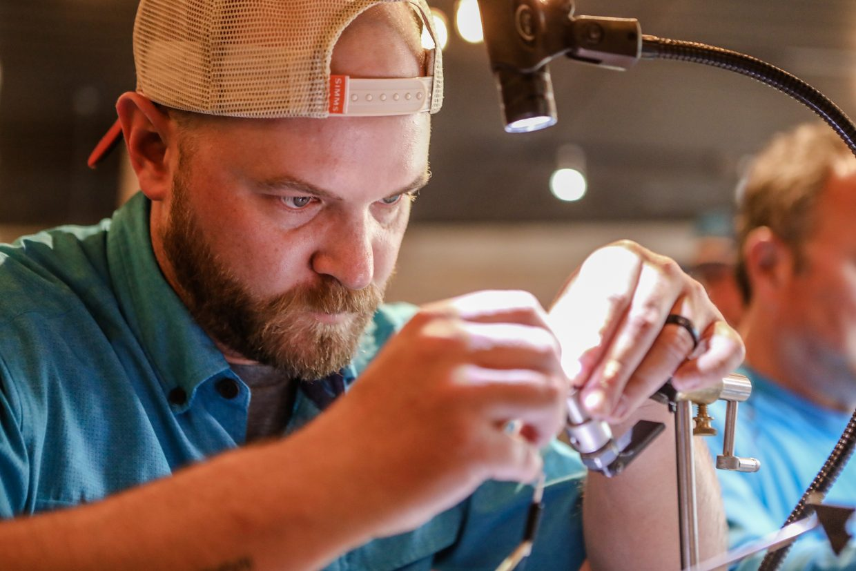 Ray Kyle of Eagle heavily concentrates on the second recond of fly tying during the Fly Tying Competition during the GoPro Mountain Games on Friday, June 8, at Vail Brewing Company tasting room in Vail. This is the first year for the event.