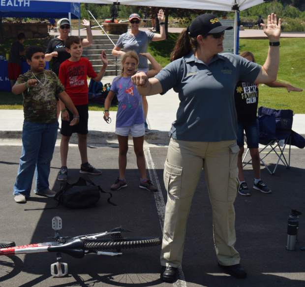 Amber Barrett with the Eagle County Sheriff's Office taught kids about bike safety, and that they are required to obey the rules of the road like any other vehicle.