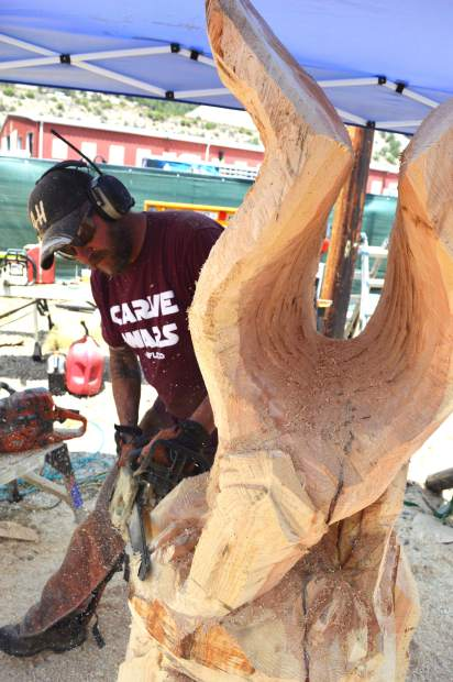 Carve wars unchains chainsaw artists. wood sculpting event making
