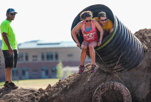 Jacob and Katie Rivera check out the drop during the annual Mud Run on Saturday, July 14, in Gypsum. Participants had to crawl up the tube and jump into a muddy pool.