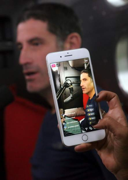 WEDU editorial director Julia Polloreno takes a picture of George Hincapie during Lance Armstrong's Tour de France podcast