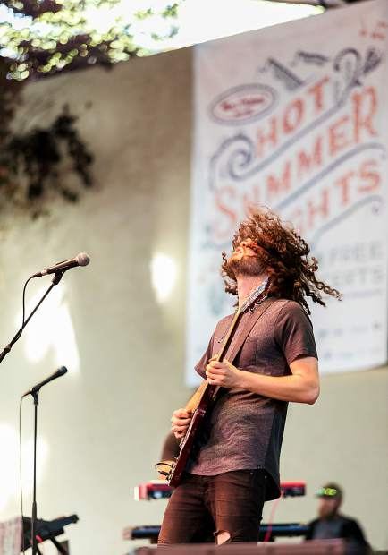 Max Newman rips on his guitair during a lengthy solo during The Main Squeeze's performance for the Hot Summer Nights concert series Tuesday in Vail.