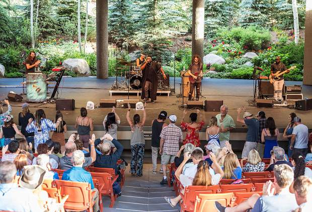 The Main Squeeze, a funk band out of Chicago, perform for a dancing crowd during the Hot Summer Nights concert series Tuesday in Vail.