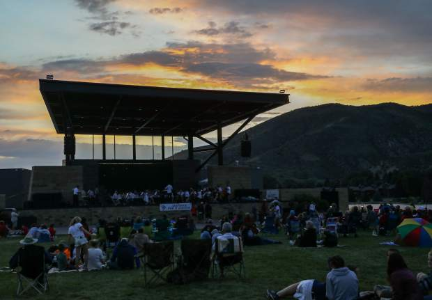 The Arapahoe Philharmonic plays the 32nd annual Alpine Bank's Salute to the USA on Tuesday, July 3, in Avon. Showers gave way to a beautiful night and sunset.