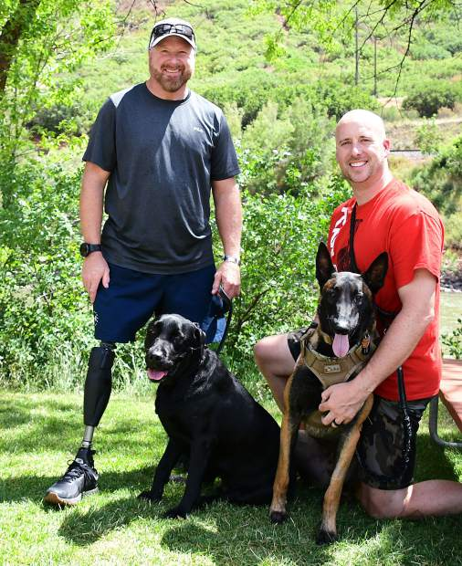Carl Hill with dog Maximus and Peter Way with Rory are in town with the Vail Veterans Program.