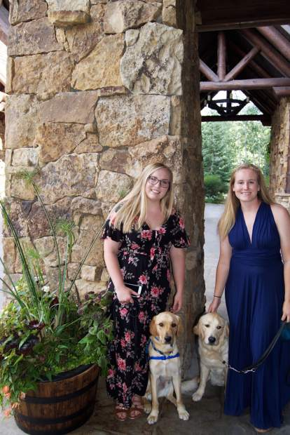 Ashley Wilt and Elijiah and Emily Oltmanns and Haddix take a walk outside the Ritz-Carlton Bachelor Gulch before the Canine Companions for Independence fundraising gala.