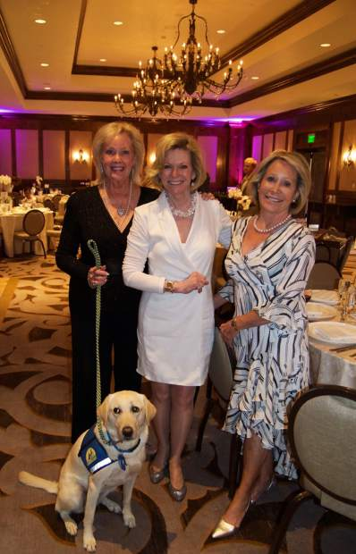 Event chairs Kay Michelsen and Mary Ellen Anderson honored Anne Roberts, center, founding president of the Vail Valley Chapter of Canine Companions, at the Puttin' on the Ritz Gala.