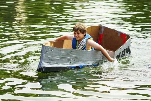 Ten-year-old Logan Daniels ditched his duct tape paddle before winning the best sinking boat at the Cardboard Boat Regatta. Photo By- Rachael Zimmerman