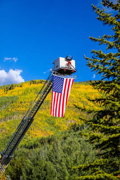 The American Flag is flown above the changing colors of Vail.