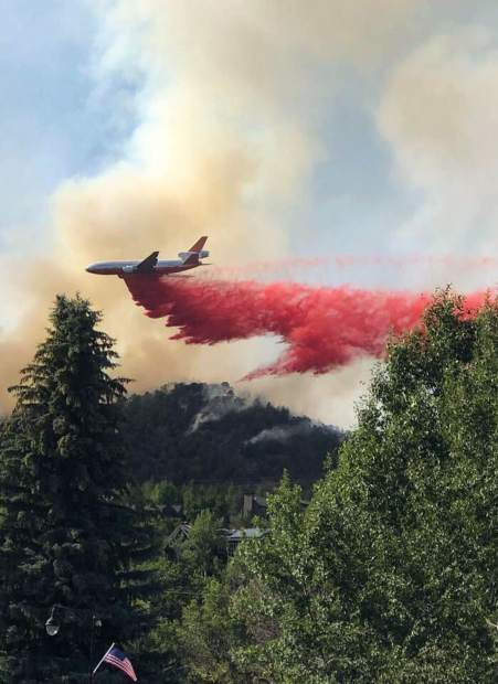 Hundreds of airdrops and thousands of fire fighters battled the blaze. Some are still there.