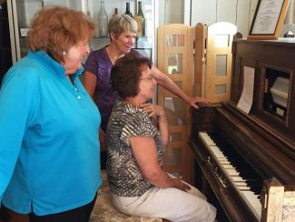 Tickling the ivorys, using your feet: Nottingham player piano joins artifacts at Eagle museum