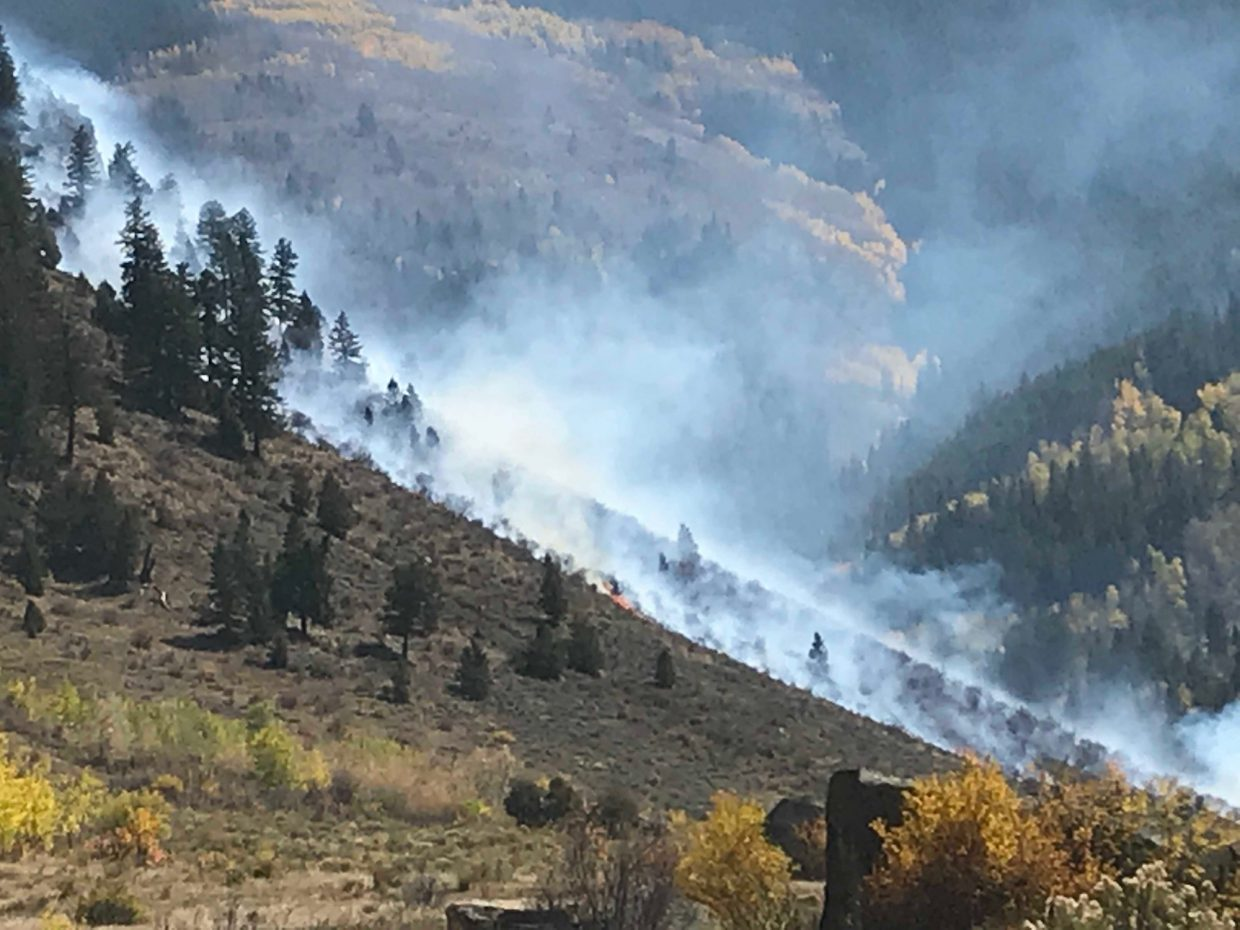 Flames climb up the hillside from the Minturn shooting range on Saturday, Sept. 29.