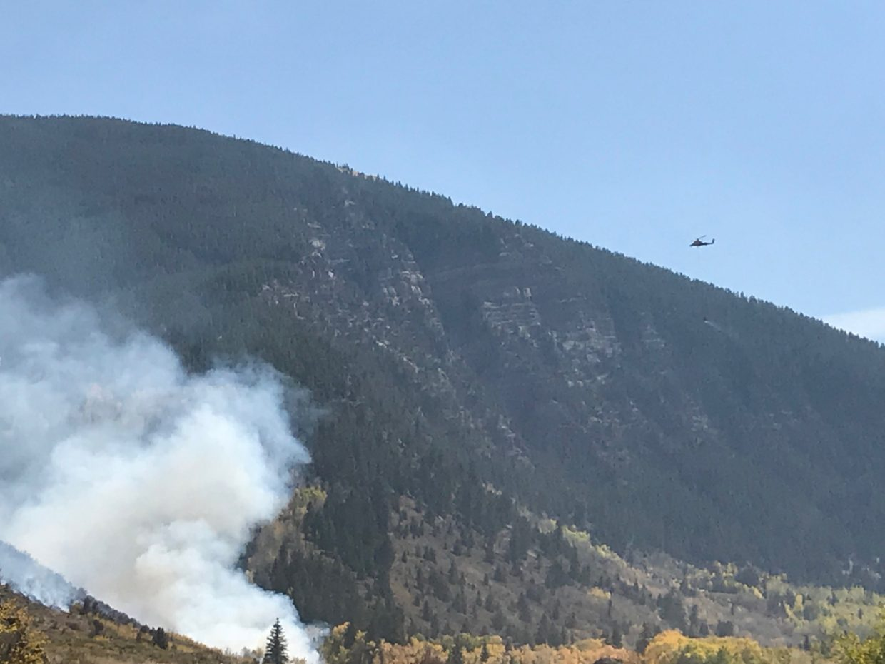 A helicopter responds to a wild land fire at the Minturn shooting range on Saturday, Sept. 29.