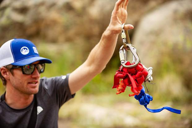 Aspen Alpine Guide Nate Rowland holds up his rack of gear he takes mountaineering for a field planning and safety clinic August 25.
