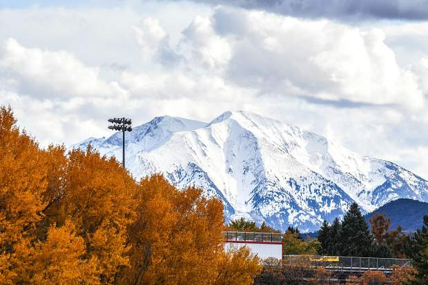 Mount Sopris shines through the clouds on a chilly fall afternoon in Glenwood Springs on Tuesday, Oct 23.