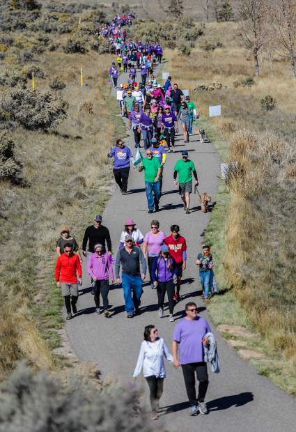 People walk in the Alzheimer's for the Walk to End Alzheimer's Saturday, Oct. 20, at Brush Creek Pavilion in Eagle. The walk was about two miles.