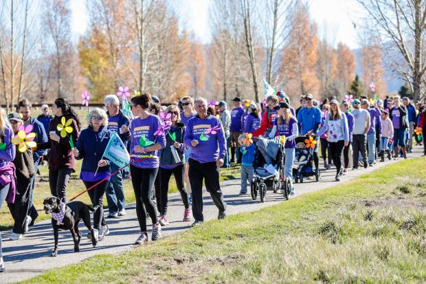 People walk in the Alzheimer's for the Walk to End Alzheimer's Saturday, Oct. 20, at Brush Creek Pavilion in Eagle. The walk takes place in about 600 communities around the country. As of the morning of the walk, $80,000 had been raised of the $100,000 goal.