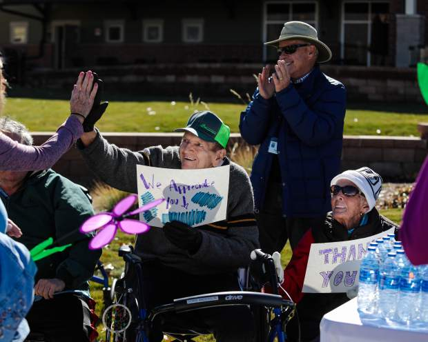 Residents of Castle Peak Senior Life and Rehabilitation cheer on walkers of the Walk to End Alzheimer's Saturday, Oct. 20, in Eagle. The morning of the walk $80,000 had already been donated of the $100k goal.