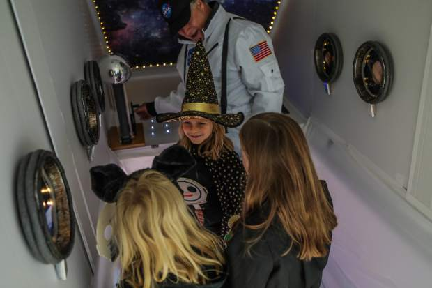 Amelia and Lily Linton and Samantha Conlin of East Vail check out the space ship for the Walking Mountains Science Center Fright at the Museum Saturday, Oct. 27, in Avon. The station taught kids about static electricity.